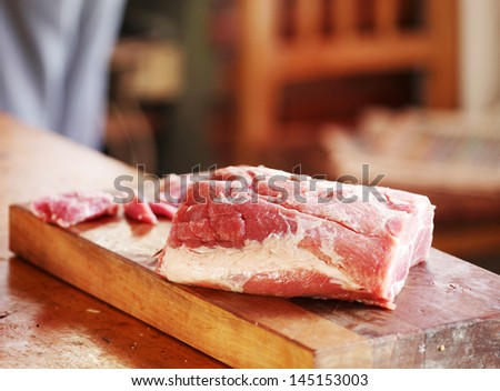 Raw pork on cutting board.