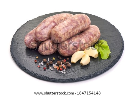 Raw pork Sausages, isolated on white background. Foto d'archivio ©