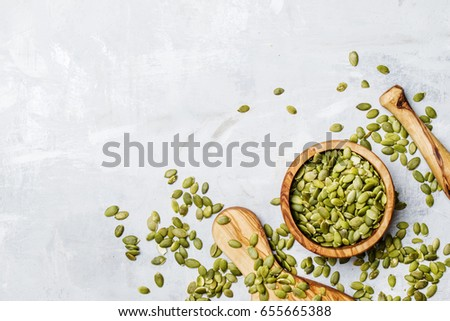 Raw pumpkin seeds, food background, top view #655665388