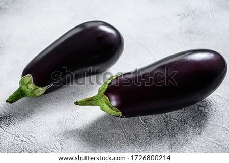 Raw purple eggplant. Organic vegetables. Gray background. Top view Сток-фото ©