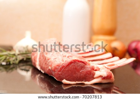 Raw rack of lamb being made ready for cooking