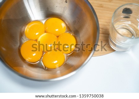 Raw raw egg yolk #1359750038
