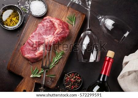 Raw ribeye beef steak cooking with ingredients. Top view  #572299591