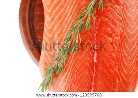 raw salmon fillet isolated on wooden plate with rosemary