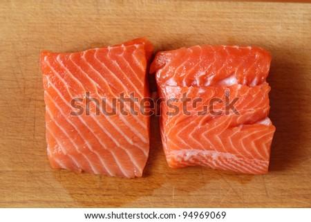Raw Salmon Fillet on kitchen board (soft focus)