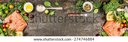 Raw salmon fillet with cooking ingredients: oil, fresh seasoning, spoon and fork on rustic wooden background, top view, banner for website.