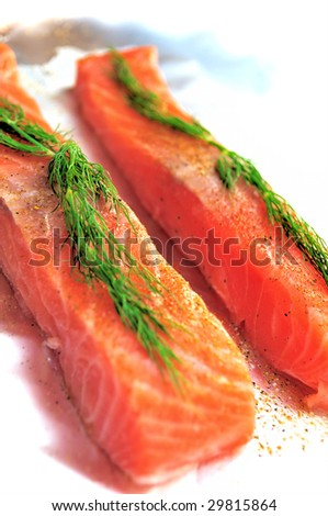 Raw salmon flesh exciting foil before grilling - stock photo