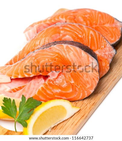 raw salmon on cutting board - stock photo