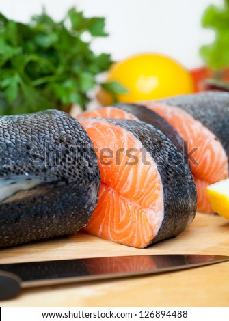 raw salmon on cutting board