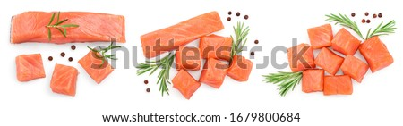 raw salmon piece cube with rosemary and peppercorn isolated on white background close up. Set or collection
