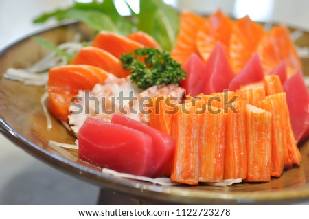 raw salmon , raw tuna and raw squid or sashimi #1122723278