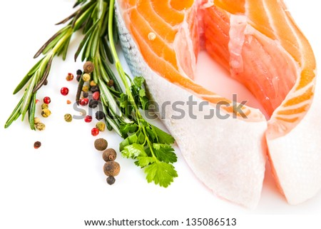 Raw salmon steak with rosemary isolated on white
