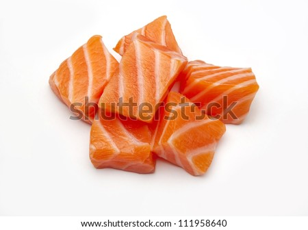 Raw salmon sushi meat cubes photographed on a white background.