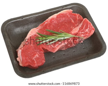 Raw sirloin beef steak in styrofoam packaging tray.