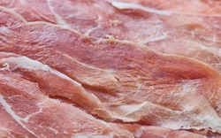Raw sluggish Italian ham Prosciutto close-up, shallow depth of field
