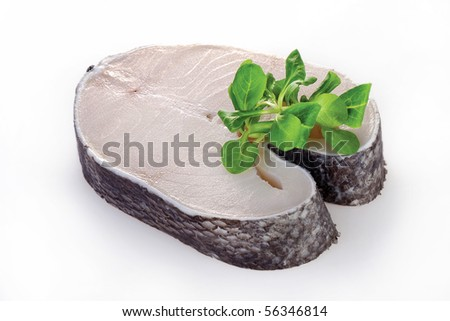 Raw steak of white fish salad on white background