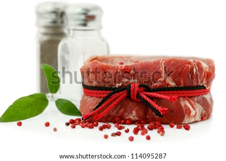 Raw Steak with red peppercorns and Ingredient Isolated on White