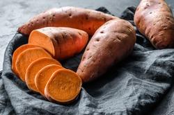 Raw sweet potatoes, organic yam. The farm food. Black background.