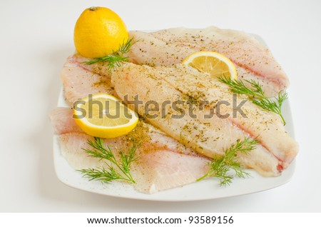 Raw tilapia fillets marinated in lemon juice