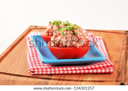 Raw tomatoes stuffed with ground meat