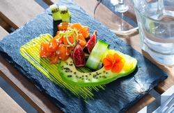 Raw tuna tartare served with avocado and spicy mango sauce