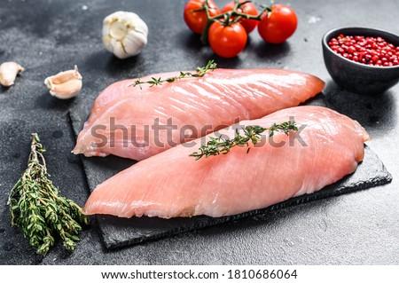Raw Turkey Breasts. Fillet steak. Black background. Top view Сток-фото ©