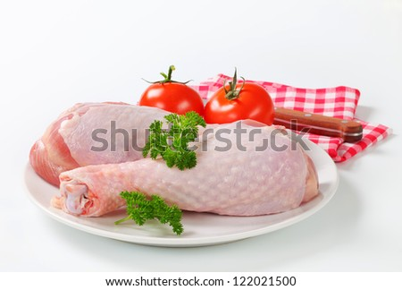 Raw turkey legs with tomatoes