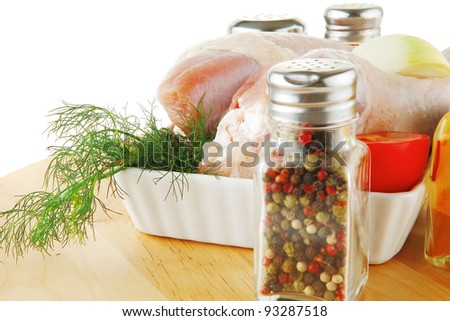 raw uncooked legs on wooden plate over white - stock photo