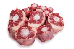 Raw uncooked ox tail portions on white isolated background.