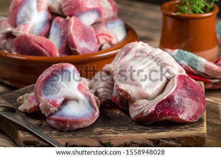 Raw uncooked turkey gizzards. Shallow depth of field.