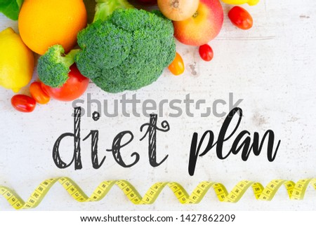 raw vagetables on white table with diet plan words, healthy diet concept #1427862209