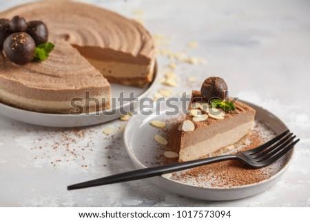 Raw vegan chocolate-caramel cheesecake with raw balls. Healthy vegan dessert food concept.