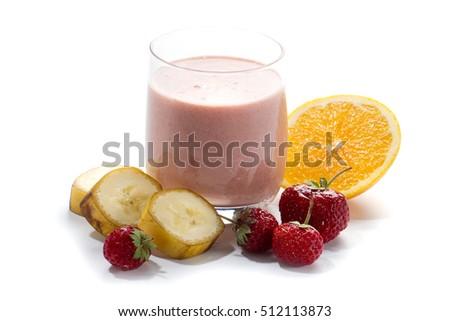 Stock Photo Raw vegan food: banana, orange and strawberry smoothie