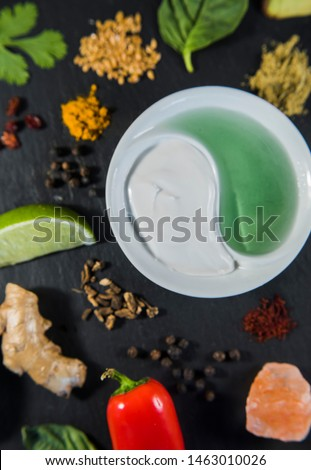raw vegan ingredients, fresh ingredients, coconut cream, aloe, lemon, avocado, parsley, basil, peppers, ginger, rosebuds, and spices