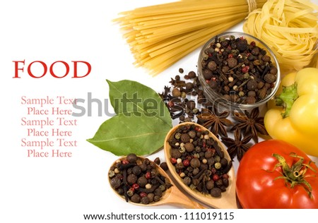 raw vegetables, spices and pasta on a white background