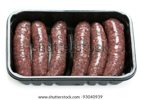 raw venison sausages in a supermarket plastic tray