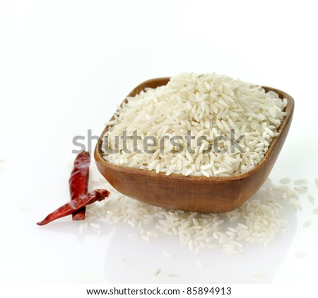 raw white rice , close up in a wooden bowl