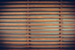 Raw wood, wooden slatted fence or lath wall background texture, vintage tone with vignet