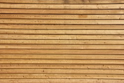 Raw wood, wooden slatted fence or wall
