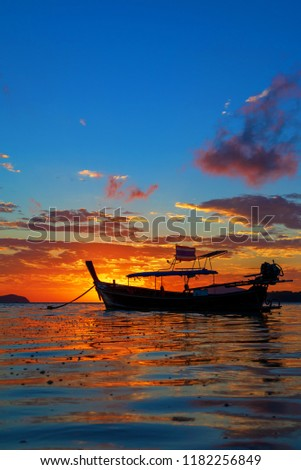 Rawai beach with andaman long tailed boat southern of thailand floating on clear sea water with sun shine in phuket