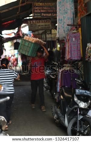 Rawakalong, Bekasi District, West Java, Indonesia - February 24, 2019.   hunting photo on bekasitraditional markets. #1326417107