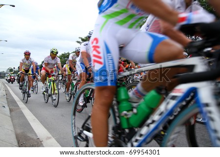 RAWANG-JANUARY 28: Cyclists from various teams cycle during Stage 6 of the Tour de Langkawi from Rawang to Putrajaya on January 28 2011 in Rawang, Malaysia