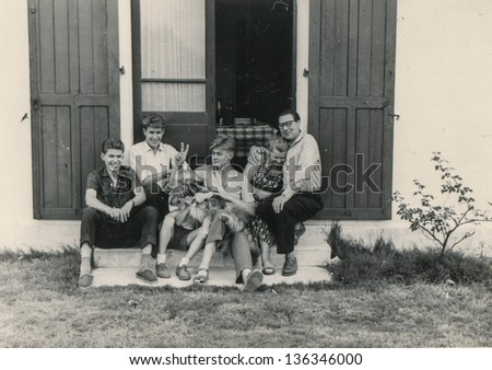 RAWICZ, POLAND, CIRCA 1947 - Vintage photo unidentified family posing in front of their house together with a dog, Rawicz, Poland, circa 1947