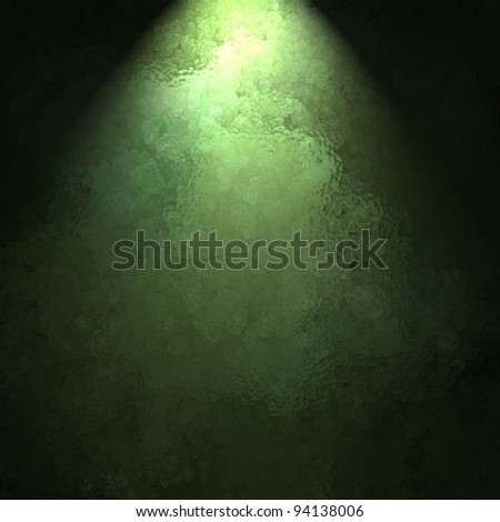 ray or beam of sunlight on marbled green background wall with black border and copy space for ad display or St. Patrick's day or Christmas announcement or invitation to party