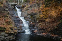 Raymondskill Falls in Autumn surrounded with brilliant fall foliage in the Pennsylvania Poconos