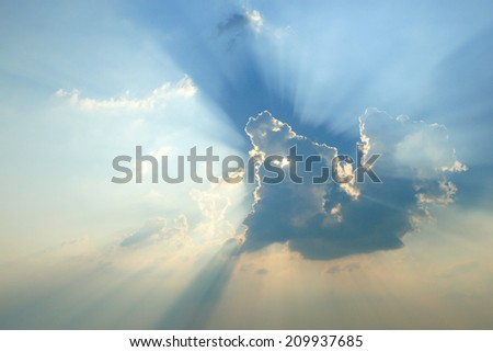 Rays of light in abstract shape. Sun light bursting through the clouds