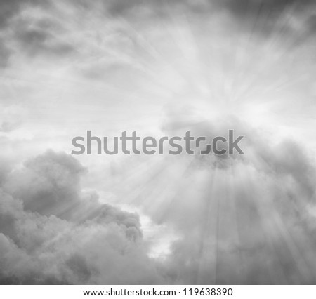 Rays of light in grey sky