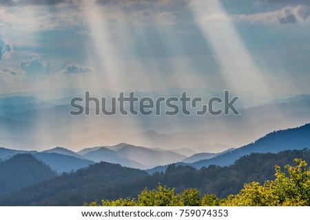 Rays of Sun Shine Over the Blue Ridge Mountains in North Carolina #759074353