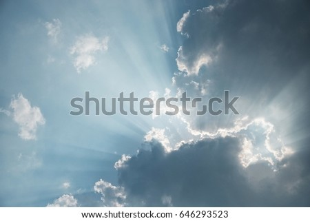 rays of sunlight  through dark clouds