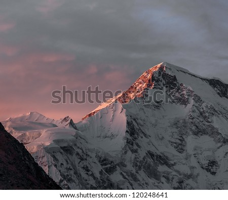 Rays of sunset on the tops of the mountains - Gokyo region, Nepal